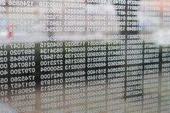 Números em uma parede de vidro imagens de stock