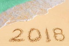 Números 2018 en la playa Imagen de archivo libre de regalías