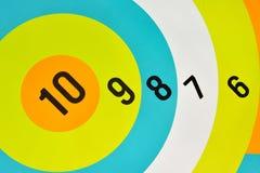 Números en tablero de dardos Fotografía de archivo libre de regalías