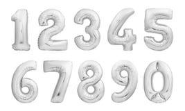 Números hechos de los globos inflables de plata Imágenes de archivo libres de regalías