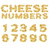 Números hechos del queso en diseño plano Fotos de archivo libres de regalías