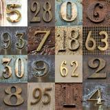 Números no metal como um fundo imagens de stock