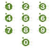 Números no respingo verde da pintura de óleo no fundo branco Imagens de Stock