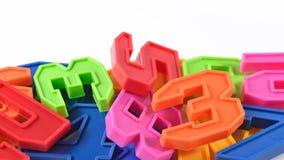 Números plásticos coloridos en blanco Foto de archivo libre de regalías