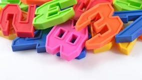Números plásticos coloridos en blanco Imagen de archivo libre de regalías