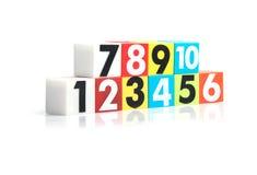 Números plásticos coloridos en el fondo blanco Imagen de archivo libre de regalías