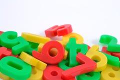 Números plásticos coloridos no branco Fotografia de Stock Royalty Free