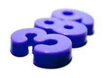 Números plásticos púrpuras Fotos de archivo libres de regalías