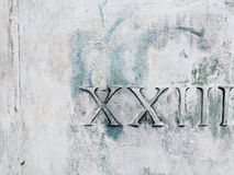 Números romanos veintitrés en blanco y verde imágenes de archivo libres de regalías