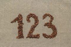 Números uno, dos, tres de los granos de café Fotografía de archivo libre de regalías