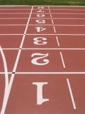 Números verticais de trilha do atletismo. imagens de stock royalty free