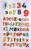 Números y 26 alphablets del color Fotografía de archivo