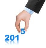 Números 2015 y mano Imagenes de archivo