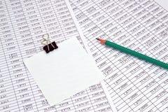 Números y nota Imagen de archivo