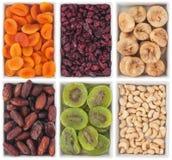 Nüsse und Trockenfrüchte in der keramischen Platte Stockfotos