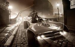 Nęcący żeński kierowca w retro samochodzie Obraz Royalty Free