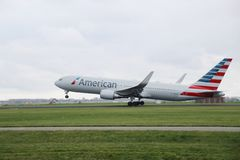 N393AN American Airlines Boeing 767-323 is departing from Polderbaan. 18R - 36L on Amsterdam schiphol airport in the Netherlands royalty free stock images