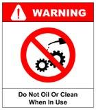 N'huilez pas ou ne nettoyez pas en service Roue dentée Retenez une fois fonctionné Symbo rouge de avertissement image stock