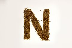 N letter. the alphabet of buckwheat. Porridge. buckwheat grain. concept of healthy eating. photo for your design. horizontal sheet orientation royalty free stock photo