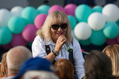 N. Melnik sing a song with spectators. PODOLSK, RUSSIA - SEPTEMBER 9, 2018: N. Melnik sing a song with spectators on Day of the Moscow city. Event in Znamya stock photography