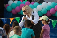 N. Melnik sing a song with spectators. PODOLSK, RUSSIA - SEPTEMBER 9, 2018: N. Melnik sing a song with spectators on Day of the Moscow city. Event in Znamya royalty free stock photography