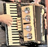 Joy and beauty in the Accordion. N254/5000nThe accordion is a harmonic wind musical instrument, composed of a bellows, a tenfão and two boxes of harmony of wood Royalty Free Stock Photo