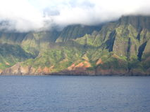 Nā Pali Coast State Park. Taken from a Cruise Ship, the Na Pali coast in Kauai is in the clouds Royalty Free Stock Photo