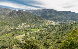 N197 road heads towards the coast in Corsica Stock Images