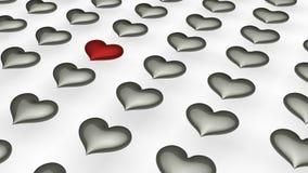 Één rood hart binnen onder vele witte harten Stock Fotografie