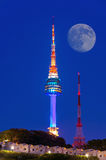 N Seoul Tower with full moon Located on Namsan Mountain in central Seoul,Korea. Stock Photography