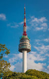 N Seoul Tower. The spire of N Seoul Tower, or Namsan Tower, and the blue skies above Seoul Stock Photos