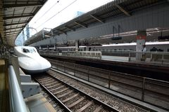 N700 series Shinkansen arriving at platform. Tokyo Station. Tokyo. Japan. The Shinkansen, or bullet train, is a network of high-speed railway lines in Japan; the Royalty Free Stock Photos