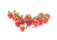 Na biały tle świezi czereśniowi pomidory Zdjęcia Stock