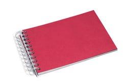 Na biel czerwony notatnik Obrazy Royalty Free