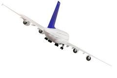 Na biel nowożytny samolot. obrazy stock