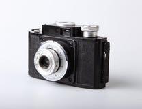 Na biel retro kamera zdjęcia stock