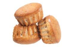 Na biel trzy muffins Obrazy Stock
