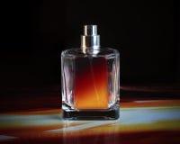 Na czarny tle pachnidło butelka obraz royalty free