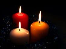 Na czarny tle trzy świeczki Obrazy Stock