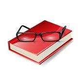 Na czerwieni książce czytelniczy szkła Fotografia Stock