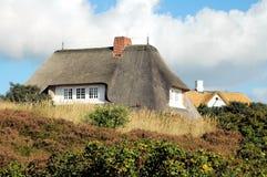 na dachu domu 3 powlekane strzechą Fotografia Stock