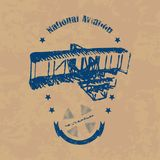 NA_emblem. Emblem with the image of an airplane in retro style on a brown vintage background Stock Image