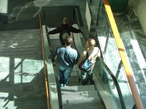 Na escada rolante Imagens de Stock Royalty Free