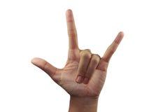 Na frente do sinal do amor da palma Imagem de Stock