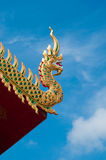 Na-ga on temple roof and blue sky. In north of thailand Royalty Free Stock Photo