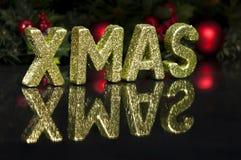 Na letra de capital escrita o Xmas, efeito do glitter Fotografia de Stock
