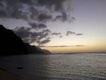 Na Pali Coast Cliffs on Kauai Island, Hawaii - View from Ke'e Beach during Sunset. Stock Photo