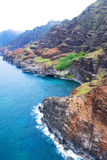 Na Pali Coast Kauai Hawaii. An aerial view of the Na Pali coast in Kauai Hawaii during a vibrant, sunny day shows the rich colors of the scenic coastline Royalty Free Stock Photos