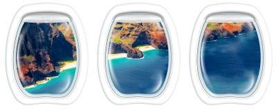 Na Pali Coast on window. Three plane windows on Na Pali coast, Kauai, Hawaii, United States, from a plane on the porthole windows. Copy space Royalty Free Stock Image