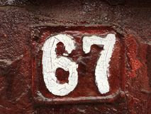 67 na placa da casa Imagem de Stock Royalty Free